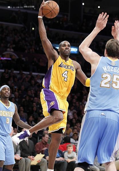 Lakers forward Antawn Jamison drives to the basket against Nuggets defenders Ty Lawson, left, and Timofey Mozgov in the second quarter on Friday.