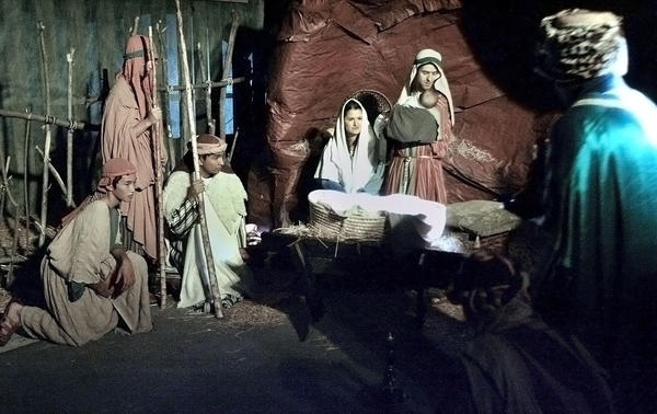 Wisemen gather at the foot of the manger during a live nativity performance at the First Annual Christmas Nativity Festival in Burbank at the Church of Jesus Christ of Latter-day Saints on Firday, November 30, 2012. The festival, with about 350 nativities and a live nativity performance will run from 4:00 to 9:00 on it's final day on Saturday.