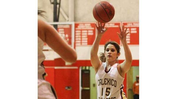 JOSELITO VILLERO PHOTO<br> Calexico High's Tanya Kallen passes the ball to a teammate against El Capitan High during the Imperial Valley Invitational girls' basketball tournament in Imperial on Friday.