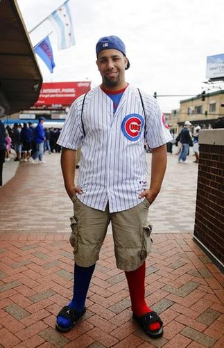 """<b>What's the story of the socks?</b> """"When I was little I played soccer. I had red ones and blue ones and I mixed it up (for Cubs games). I've been doing this every year since, probably, I was 10.""""<br> <br> <b>Does this look make you a chick magnet?</b> (Laughing) """"It's hard not to be."""""""
