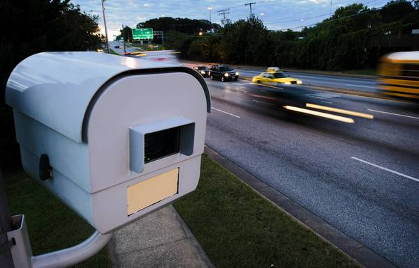 Early morning traffic passes the North bound speed camera on Caton Avenue. Traffic that comes off of Interstate 95 heading north on Caton Avenue is immediately faced with a speed camera.