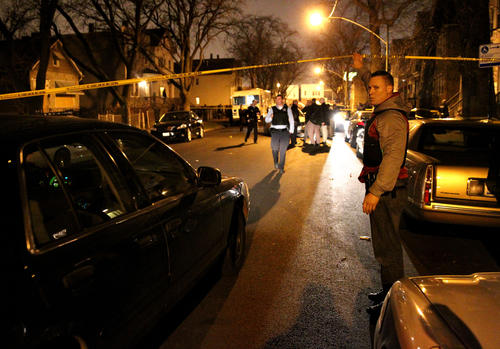 Chicago police work the scene of a shooting in the 4200 block of South Wells Street in Chicago on Friday, November 30, 2012.