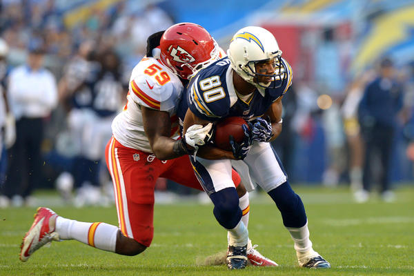 Jovan Belcher (L) tackles Malcolm Floyd at Qualcomm Stadium.