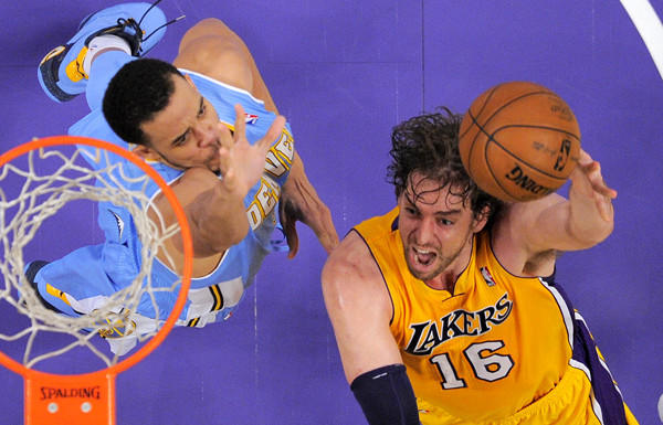 Lakers power forward Pau Gasol drives to the basket against Nuggets center JaVale McGree.