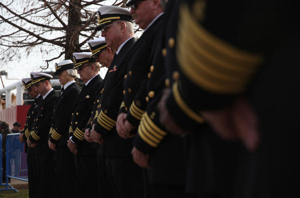 Members of the U.S. Coast Guard lower their heads for prayer during the annual U.S. Coast Guard Mackinaw Cutter's visit at Navy Pier on Saturday.