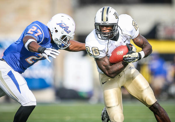 UCF running back Latavius Murray (28) runs for yardage during first quarter action of the 2012 C-USA title game against the University of Tulsa at the H.A. Chapman Stadium on Saturday, December 01, 2012 in Tulsa, OK.