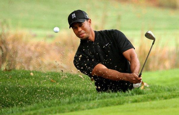 Tiger Woods hits out of a bunker at No. 4 on Saturday during the third round of the World Challenge at Sherwood Country Club in Thousand Oaks.