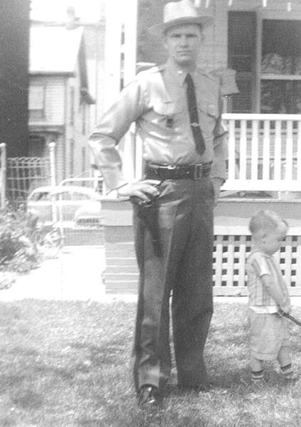 Harry Smith is shown in his Maryland State Police uniform in 1961, not long after he joined the force. Steven Smith is on the right.