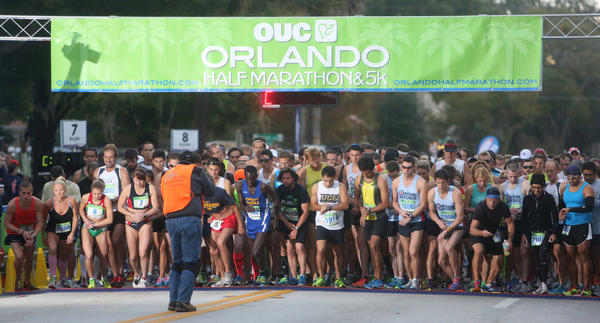 Runners get ready to start the OUC Half Marathon in downtown Orlando, Florida on Saturday, December 1, 2012.
