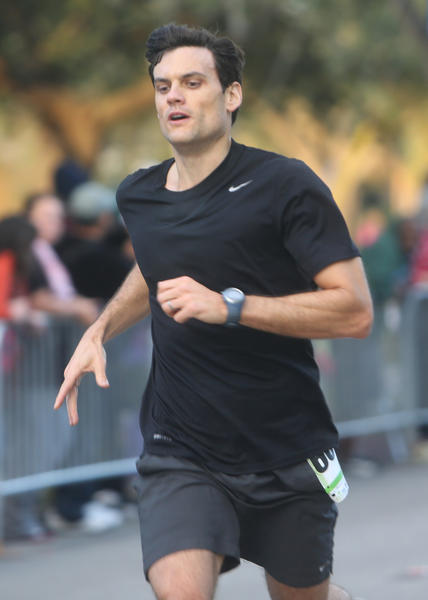 With a time of 17:56, David Witter, 36, of Winter Park finishes third in the men's group of the 5K portion of the OUC Half Marathon & 5K which took place in downtown Orlando, Florida on Saturday, December 1, 2012.