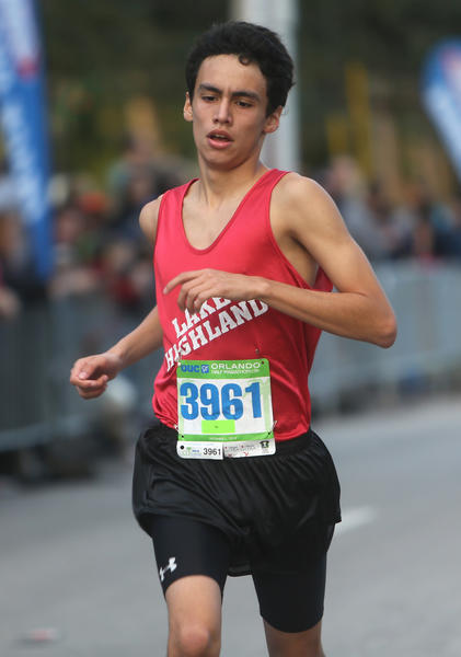 With a time of 18:49, Alejandro Nehgme, 15, of Maitland, Florida finishes fifth in the mens' group of the 5K portion of the OUC Half Marathon & 5K which took place in downtown Orlando, Florida on Saturday, December 1, 2012.