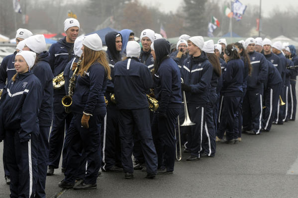 The UConn marching band waits in line for food outside the stadium before the Huskies' football game against Cincinnati.