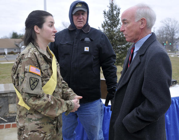 Congressman Joe Courtney, right, speaks to the woman of honor at a yellow ribbon ceremony held at Marlborough Town Hall Saturday morning in honor of Army Staff Sgt. Amy Chesky Hall.