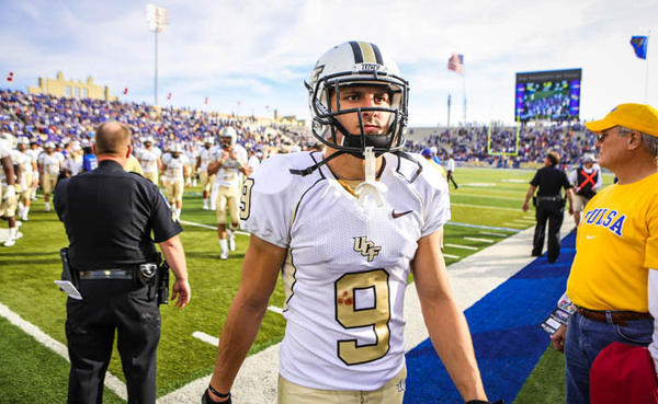 UCF's J.J. Worton (9) reacts as he leaves the field after their 33-27 overtime loss to the University of Tulsa in the 2012 C-USA title game at the H.A. Chapman Stadium on Saturday, December 01, 2012 in Tulsa, OK.