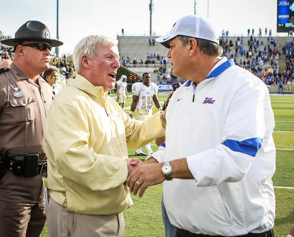 UCF coach George O'Leary shakes hands with TU coach Bill Blankenship after their 27-33 Overtime loss to the University of Tulsa in the 2012 C-USA title game at the H.A. Chapman Stadium on Saturday, December 01, 2012 in Tulsa, OK.
