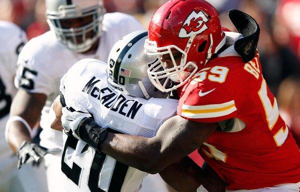 Chiefs linebacker Jovan Belcher tackles running back Darren McFadden of the Oakland Raiders during their game last month at Arrowhead Stadium.