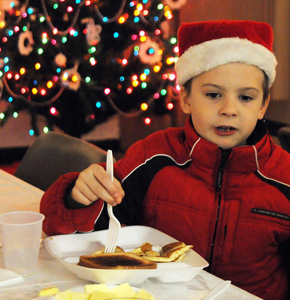 In the Christmas spirit, A. J. Caruso, 6, of Macungie, eats breakfast on Saturday during the annual breakfast with Pip the Mouse at the Liberty Bell Museum in Allentown.
