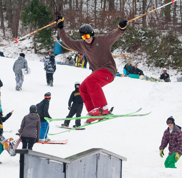 Jarid Kunkle, 17, of Kutztown, gets some air while riding one of the rails on opening day at Blue Mountain Ski Area. The ski area had one of it's earliest opening days in it's 35 year history on Saturday, December 1, 2012.