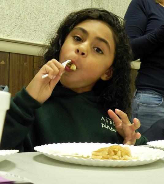 Kya Reese, 7, Waynesboro, gobbles down a pancake before rushing off to see Santa Claus at Santa's Breakfast held at the Rouzerville Ruritan Club on Saturday morning.