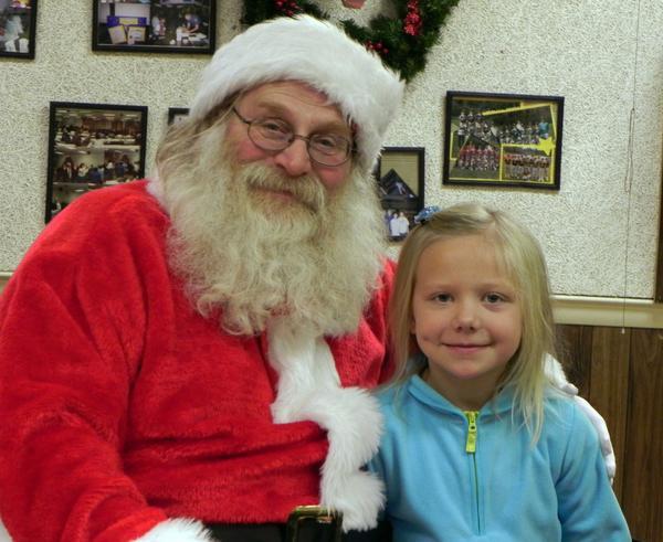 Taylor Atherton, 7, Waynesboro (Pa.), whispers her Christmas wish list to Santa Claus at Saturday's Santa Breakfast at the Rouzerville Ruritan Club.
