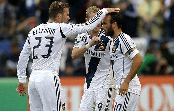 Galaxy forward Landon Donovan (10) is congratulated by midfielders David Beckham and Christian Wilhelmsson (9) after scoring on a penalty kick against the Dynamo in the second half Saturday.