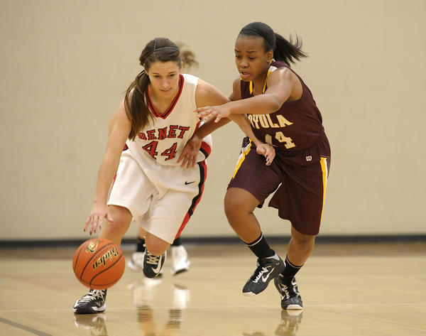 Loyola's Tyra Mills pressures Benet's Marissa Panko. Benet defeated Loyola 54-29 on Sat., Dec. 1, 2012, at Benet Academy in Lisle, Ill.