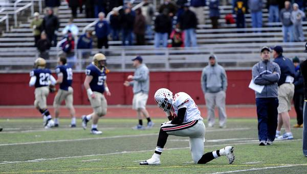 Parkland's Jarey Elder pauses after Parkland lost to LaSalle 28 to 7 in the PIAA quarter final game played at Northeast High School in Philadelphia on December 1, 2012.
