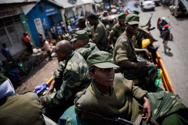 M23 rebels wait on a truck before their departure rom the city of Goma in eastern Congo.