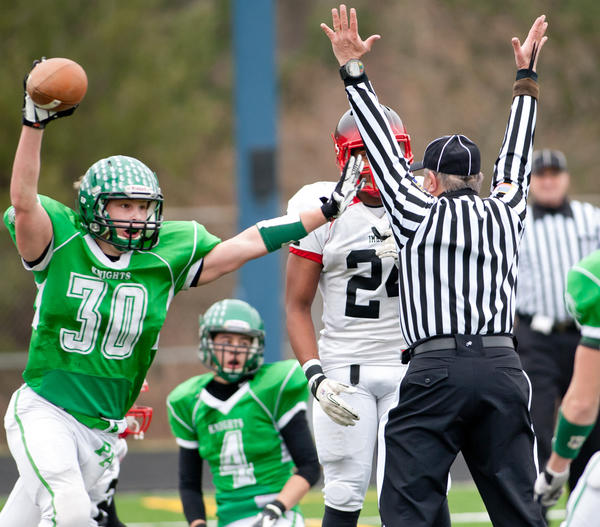 Pen Argyl's Scott Beltz (30) celebrates his catch on a deflection in the end zone for their only touchdown in the game as the Green Knights were shut down by Imhotep's defense. Imhotep dominated their PIAA class 2A Quarterfinal 54-7 at Northern Lehigh High School Community Stadium in Slatington on Saturday afternoon.