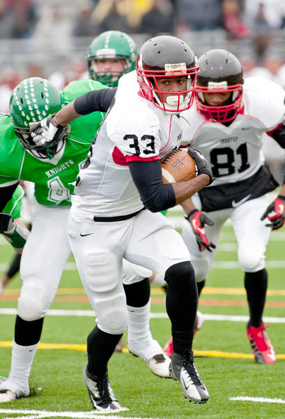 Imhotep running back David Williams (33) takes the ball upfield against Pen Argyl's ineffective defense as Imhotep dominated their PIAA class 2A Quarterfinal 54-7 at Northern Lehigh High School Community Stadium in Slatington on Saturday afternoon.
