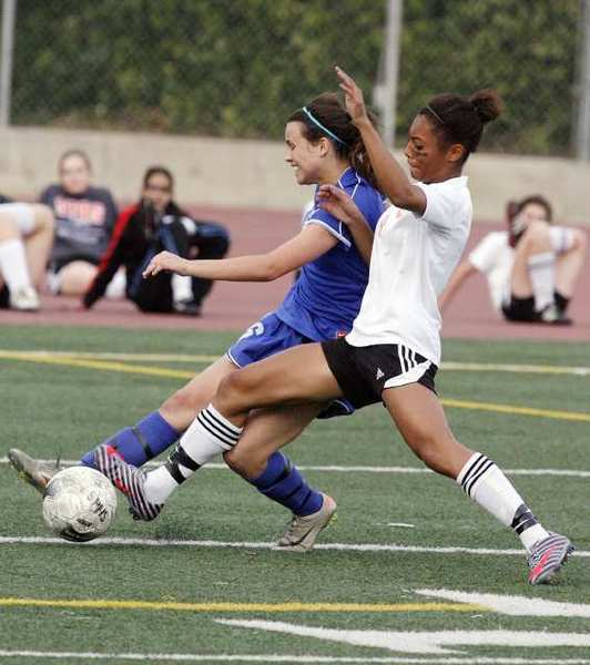 San Marino's Alex Schuster, left, and South Pasadena's Kelly Brady, right, will lead their teams to battle for control of the Rio Hondo League as the girls' soccer season gets underway. (File Photo)
