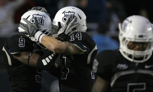 Larry Pinkard celebrates with Taylor Heinicke after catching a 73 yard pass from Heinicke during the forth quarter at Foreman Field on Saturday, December 1, 2012.