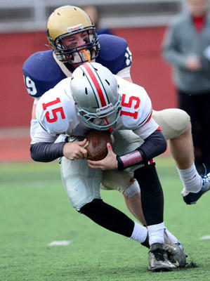 Parkland's quarterback Tim Baranek is sacked in 3rd quarter.