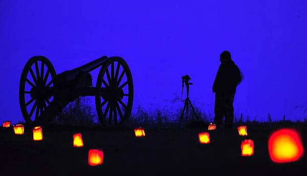 A photographer waits on a long exposure with his camera Saturday evening at Antietam National Battlefield.