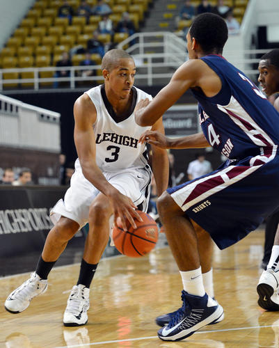 Lehigh's C.J. McCollum (3) dribbles against Fairleigh Dickinson's Kyle Pearson (34) during a men's basketball held at Stabler Arena on Saturday.