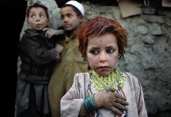 Five-year-old Agira is part of the family of Abdel Shakur, displaced Afghans from Laghman province. Now in a makeshift camp on the outskirts of Kabul, the children collect trash to burn for cooking and warmth as winter approaches.