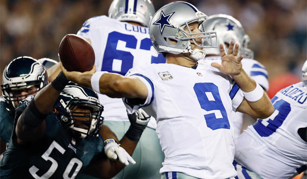 Dallas quarterback Tony Romo, shown facing pressure from Philadelphia's DeMeco Ryans, has thrown for 26 touchdowns with 16 interceptions this season.