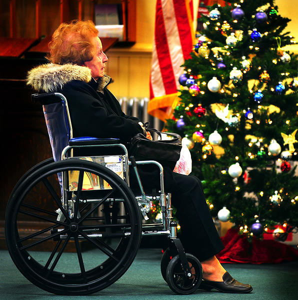 Ruth Douglas of Linthicum Heights, Md., pauses to admire lights and decorations Saturday at Trinity Lutheran Church during Smithsburg Hometown Christmas. She was visiting her daughter in Smithsburg.