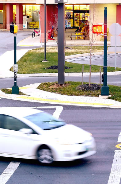 The crosswalk between Long Meadow Shopping Center and Stone House Square allows walkers 30 seconds to cross the street but still permits traffic leaving either shopping center to exit and cross the pedestrian walkway.