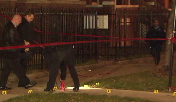 Police at the scene of a shooting that left a boy and a girl, both 14, wounded tonight.
