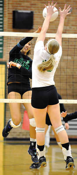 Williamsport's Stacey Christy, left, tries to spike the ball past North Hagerstown's Peyton Wallech during Saturday's Spikefest at South Hagerstown High School.