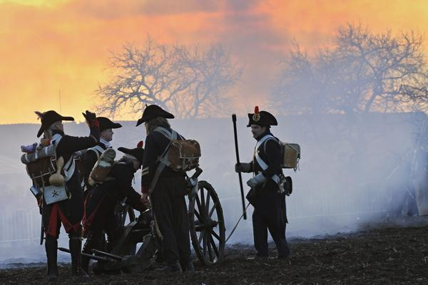 History enthusiasts dressed as soldiers take part in a re-enactment of Napoleon's 1805 Battle of Austerlitz near the South Moravian city of Slavkov, Czech Republic.