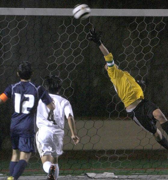 St. Francis High's goalie Ryan Veiga can't reach the ball as it sails in for a goal for Crescenta Valley High's #3 Justin Wright (not pictures) during play in the Ralph Brandt Tournament at St. Francis High School in La Canada Flintridge on Saturday, December 1, 2012.
