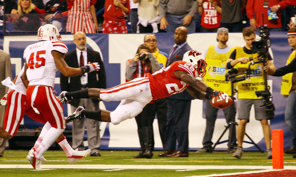 Wisconsin running back Monte Ball dives into the end zone for a touchdown past Nebraska linebacker Alonzo Whaley.
