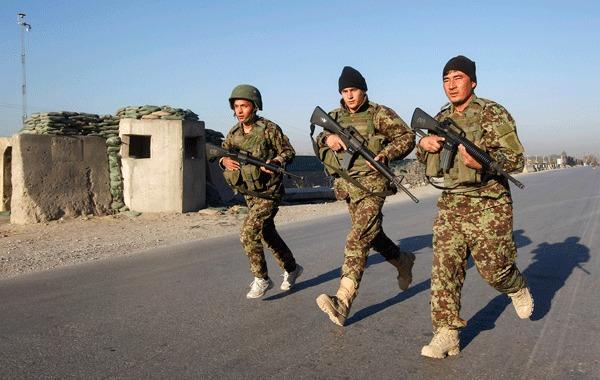 Afghan National Army (ANA) soldiers arrive at the site of an attack in Jalalabad December 2, 2012.