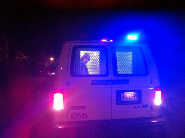 Frank James MacArthur is taken into custody by Baltimore City Police Saturday night in Waverly.