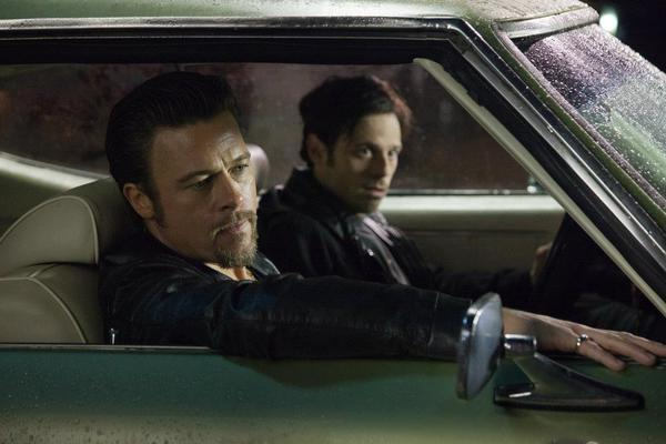 "Brad Pitt, left, and Scoot McNairy star in ""Killing Them Softly,"" which bombed at the box office this weekend."