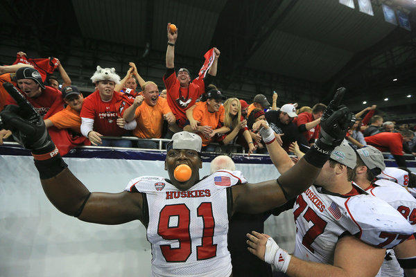 Anthony Wells (91) celebrates with fans after Northern Illinois defeated the Kent State Huskies for the Mid-American Conference championship at Ford Field in Detroit.