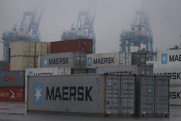 Fog shrouds the normally busy cranes at the APM Terminal at the Port of Los Angeles. The strike that has idled 10 of 14 cargo container terminals at the ports of L.A. and Long Beach began here last Tuesday.