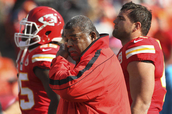 Chiefs Coach Romeo Crennel wipes his eyes during an emotional start to the game against the Panthers on Sunday at Arrowhead Stadium.